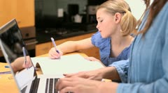Little girl drawing on her notebook Stock Footage