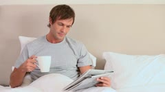 Man reading a magazine Stock Footage