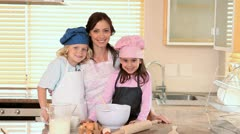 Smiling mother cooking with her children Stock Footage
