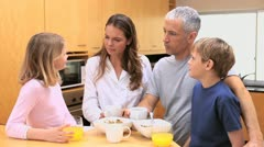 Happy family eating their breakfast Stock Footage