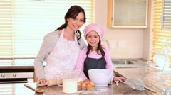 Smiling mother and daughter standing upright Stock Footage