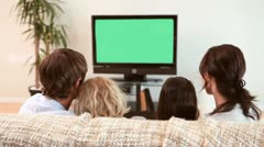 Family sitting while watching the television - stock footage