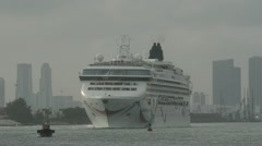 Cruise ship departing port Stock Footage