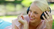 Close up of a woman listening to music and moving her head to the rhythm Stock Footage