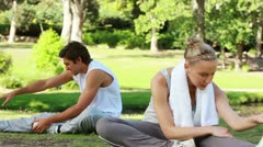 A couple stretch out and prepare for training Stock Footage