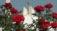 Crescent of Faisal Mosque behind red roses, Islam in Pakistan Stock Footage