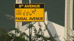 Traffic sign with Faisal Mosque in the background Stock Footage