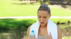 A woman takes a drink of water as the camera changes to a side view Stock Footage