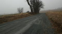 Two Cars Driving by on Gravel Road Stock Footage