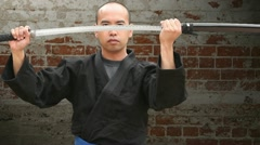 Sword Draw and Cuts Brick Background with Zoom Stock Footage