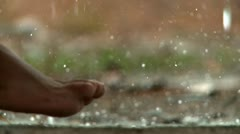 Stock Video Footage of Feet in Rain Shower
