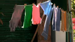 Clothes drying on line in a village Stock Footage