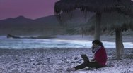 Girl with laptop on beach Stock Footage