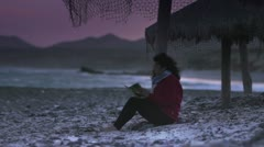 Girl reading on the beach 2 Stock Footage