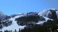 Skiers skiing down hills at a ski resort Stock Footage