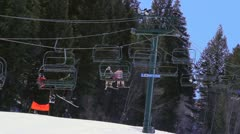 Stock Video Footage of Skiers on Chairlift
