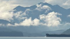 Oil Tanker Under Way Past Cloudy Mountains Stock Footage
