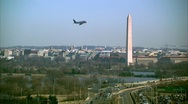 Stock Video Footage of Washington Monument Traffic Airplane Winter