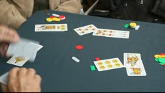 Retired persons senior citizens play card games Stock Footage