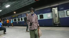 Old man begging at indian railway station Stock Footage