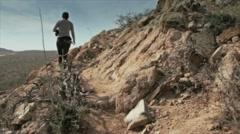 Girl walk on hill Stock Footage