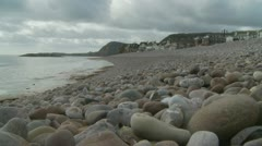 Pebbled beach in Devon Stock Footage
