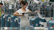 China textile industry female labor at work Stock Footage