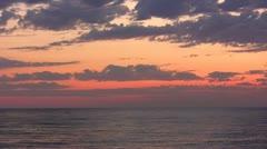 Sundown with clouds on seaside Stock Footage