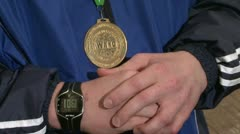 Gold medal on his chest Stock Footage