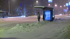 Streets covered with snow during the night, bus stop - stock footage