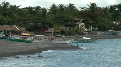 Boats laying on a black sand beach on Panay island in Philippines Stock Footage