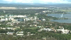 Stock Video Footage of Aerial view of buildings and fountain in lake in city Canberra