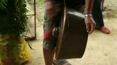 Person hitting a metal drum Stock Footage
