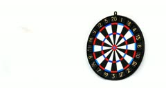 Darts stucks in a target Stock Footage
