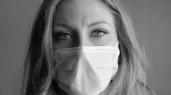 Young woman with medical mask. Black and white. Stock Footage