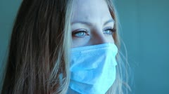 Young woman with medical mask. Two shots. Stock Footage