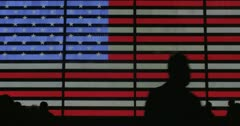 American Flag LED sign with silhouetted people walking in front 4K Stock Footage