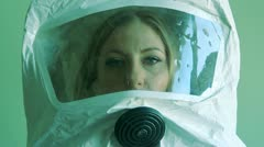 Young woman wearing safety suit. Stock Footage
