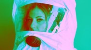 Stock Video Footage of Young woman wearing safety suit. Three quarter view. Psychedelic colours.