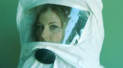 Young woman wearing safety suit. Three quarter view. Stock Footage