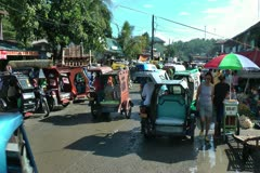Busy street during market day in Sibalom in the Republic of the Philippines Stock Footage