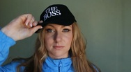 Young woman puts on 'The Boss' hat. Stock Footage