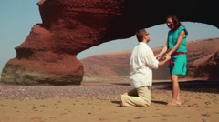 Man proposing marriage to surprised woman on the Legzira beach HD Stock Footage