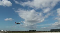 A commercial passenger aircraft across a sunny sky Stock Footage
