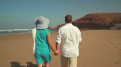 Couple in love walking on the beach, steadicam shot HD Stock Footage