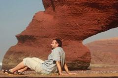 Happy young man relaxing on Legzira beach NTSC Stock Footage