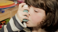 Small girl using asthma inhaler Stock Footage