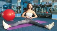 Stock Video Footage of Young Woman Working Out At The Gym