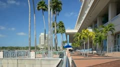 Tampa convention center seen from riverwalk along Hillsborough River Stock Footage