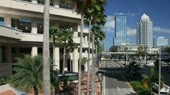 Tampa Convention Center with downtown skyline in background Stock Footage